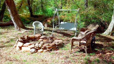 Photo: Creekside sitting area with a firepit.