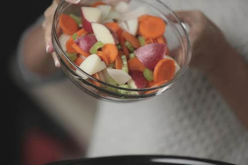 Then, add vegetables to slow cooker/crock pot. Again, being careful not to...
