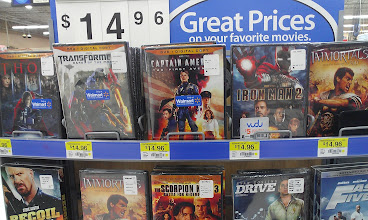 Photo: We noticed that the movies in the center aisle were decked out with Avenger-esque movies.