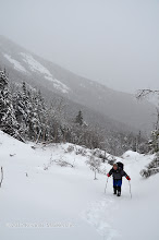Photo: Breaking trail up the first pitch. Notice the slides on the southern side Dix' eastern ridge behind NP.