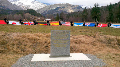 Photo: Flags symbolizing some of the nationalities of the victims, seen in this photo released by the German Embassy in France, are seen near the memorial stele in Le Vernet during a ceremony to pay tribute to the victims of an Airbus A320 in the French Alps, March 26, 2015. The co-pilot of the Germanwings airliner that crashed in the French Alps killing all 150 people aboard appears to have brought the A320 Airbus down deliberately, the Marseille prosecutor said on Thursday. German Andreas Lubitz, 28, left in sole control of the Airbus A320 after the captain left the cockpit, refused to re-open the door and operated a control that sent the plane into its final, fatal descent, the prosecutor told a news conference.   REUTERS/German Embassy in France/Handout   FOR EDITORIAL USE ONLY. NOT FOR SALE FOR MARKETING OR ADVERTISING CAMPAIGNS. THIS IMAGE HAS BEEN SUPPLIED BY A THIRD PARTY. IT IS DISTRIBUTED, EXACTLY AS RECEIVED BY REUTERS, AS A SERVICE TO CLIENTS