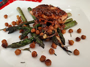 Stuffed chicken breast served on a bed of lemon pepper asparagus and crispy chickpeas.