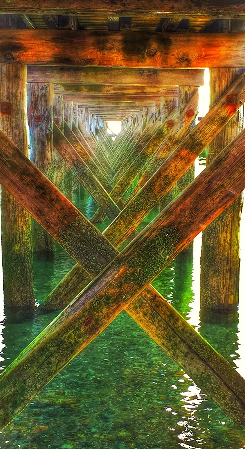 Under the pier by Ann Goldman - Novices Only Abstract ( pier hull water sunset,  )