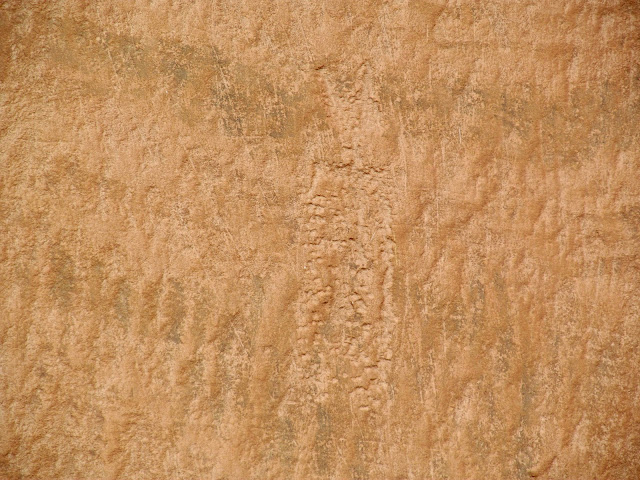 Pecked figure inside the right pictograph