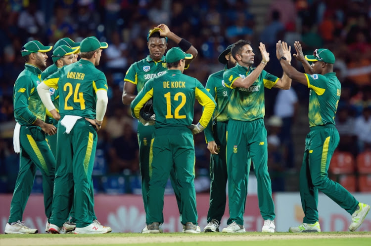 Keshav Maharaj (2nd R) of South Africa celebrates the wicket of Kusal Mendis of Sri Lanka (not in picture) with team mates during the 4th ODI between Sri Lanka and South Africa at Pallekele International Cricket Stadium on August 08, 2018 in Pallekele, Sri Lanka.