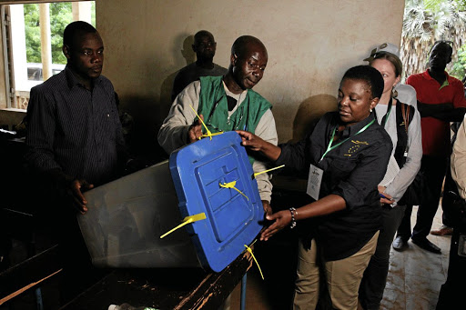 Cecile Kyenge, right, chief observer of the European Union election observation mission, holds a ballot box during the presidential election in Bamako, Mali, on July 29 2018. Picture: REUTERS