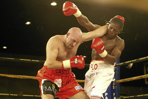 Stephen Castle, left, exchanges blows with Flo Simba during their heavyweight clash at Emperors Palace. /Antonio Muchave