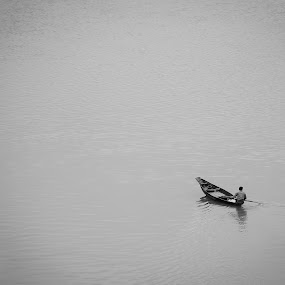 ....a journey to infinity.... by Rahat Amin - Transportation Boats ( boatman, black and white, minimalism, bw, nikon, boat, d5100, river )