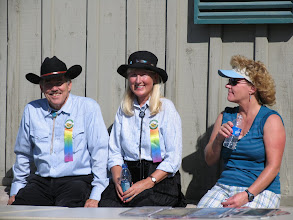 Photo: Gemini (Bruce & Renata Farwell) sport their rainbow ribbons from last evening's Coyote Howl. Sally Elloyan enjoys the sun and her husband Richard's music at Stovepipe Wells.