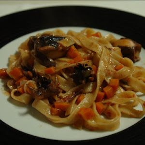 Squid with Tagliatelle Nests