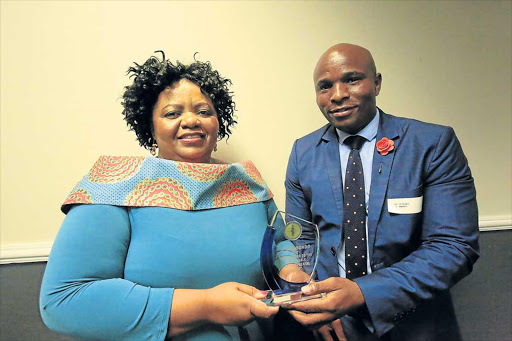 GOOD WORK: Dr Sibongile Mandondo, left, receives the local hero award from the South African Medical Association branch head, Dr Mzulungile Nodikida Picture: SINO MAJANGAZA