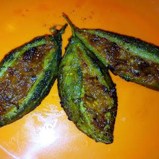 Bharwan karela recipe, how to make Stuffed Karela or stuffed bitter gourd.