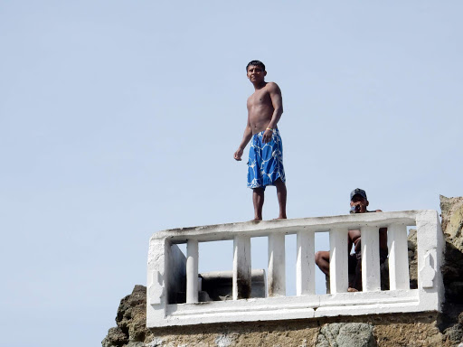 mazatlan-cliff-diver.jpg - Watch cliff divers perform at El Clavadista on the Malecon in Mazatlan, Mexico.