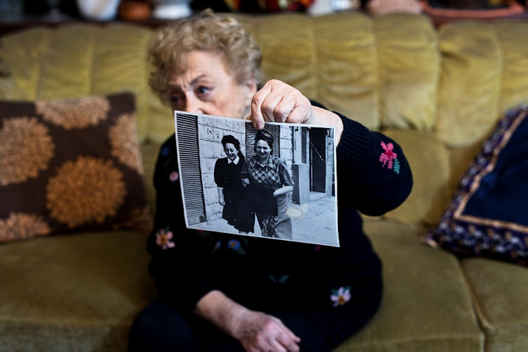 Jona Laks, survivor of Dr. Josef Mengele's twins experiments shows a photo of her and her older sister Chana, during an interview in her house in Tel Aviv, Israel January 21, 2020.