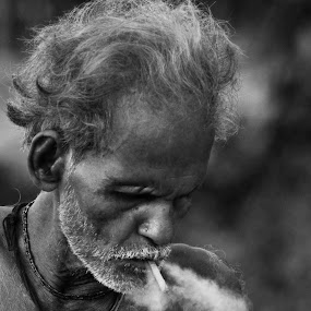 Smoking by Amit Naskar - People Portraits of Men