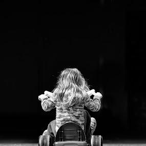 Into the Dark by Scott Hemenway - Babies & Children Children Candids ( girls, b&w, big wheels, black and white, nikon 70-20 2.8 vr ii, black & white, candid, road, fun, spring, sun, kid, playing, child, nikon d000, smile, hair, portrait, people, city, photography )