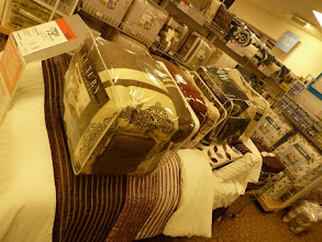 Photo: Checking out the bedding brands at Sears.