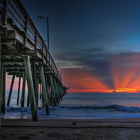 by Paul Glinowiecki - Landscapes Waterscapes ( sun rise, waterscape, pier, beach, landscape, sun rays,  )