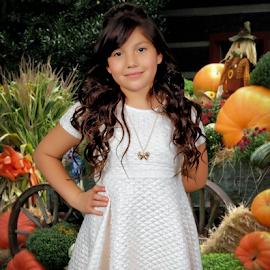 Fall season by David Salmon - Babies & Children Child Portraits ( little girl, seasonal, dark hair, fall colors, white dress )