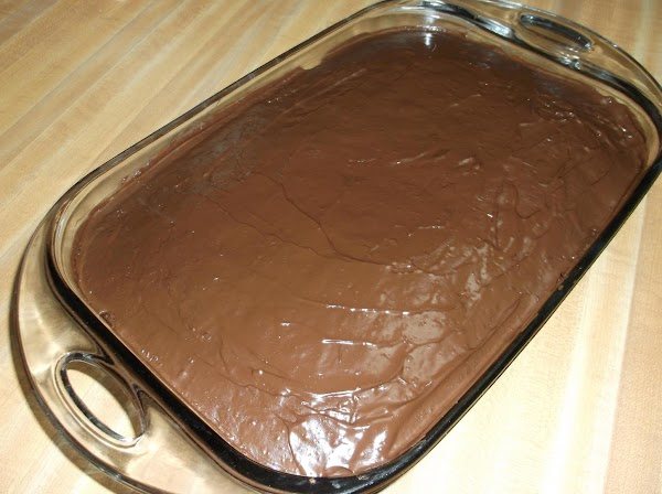 Remove cake from oven; use an off-set spatula or dinner knife to spread the...