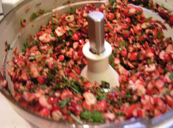 Place the cranberry in a bowl; mix together with sugar, ginger and rotel tomatoes....
