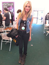 Photo: Caught the very fashionable Laura Whitmore defeating the rain backstage at Wireless