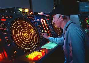 Photo: 960130-N-2302H-001?A U.S. Navy air traffic controller watches his radar scope where he works as an Aircraft Approach Controller in the Carrier Air Traffic Control Center on board the USS George Washington (CVN 73) on Jan. 30, 1996. The controller is responsible for ensuring the safe, orderly and expeditious flow of air traffic operating in the vicinity of the aircraft carrier. The nuclear powered aircraft carrier and its battle group are en route to the Mediterranean Sea for a scheduled six-month deployment.  While there, they will patrol the waters of the Adriatic Sea in support of the NATO Implementation Force (IFOR) in Operation Joint Endeavor.  DoD photo by Airman Joe Hendricks, U.S. Navy.