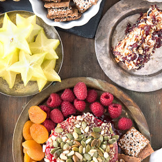 Spicy Cranberry-Raspberry Baked Brie with Toasted Hazelnuts and Pepitas.