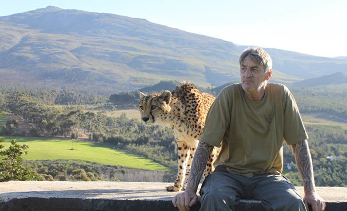 Luke Cornell and one of the cheetah actors on the farm.