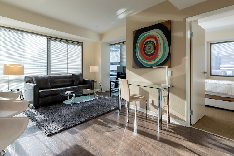 Spacious living room at Global Luxury Suites at Howard Street