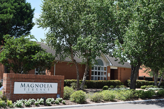 Front office view with sign for Magnolia Terrace Apartments