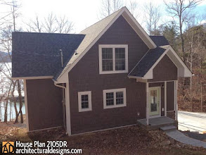 Photo: Architectural Designs Cottage House Plan 2105DR  Plan Link: http://bit.ly/2105dr  House-as-shown details:  3 bedroom home with dock and an easy walk to the water. The lot has a concrete driveway, landscaped yard, and a 32' long private dock.    3 bedroom, Master bedroom; has hard wood floors, large walkin closet with lake views, 2nd  bedroom has ceramic floors, large walkin closets and views of the lake, 3rd bedroom has hard wood floors with large closet and views of the yard and wooded areas. 3 bathroom with ceramic floors, Master bath has a large custom built ceramic shower, jacuzzi tub, granite countertop on vanity, Second bath has a custom built shower, with granite countertop on vanity, third bathroom has porcelain tub with custom tile surround with rainfall shower. Living room has hard wood flooring, large fireplace , cathedral ceiling, french doors open to porch, open floor plan, large custom ceiling fan and wired for surround sound Kitchen has ceramic floors, large eating island, granite counter tops, granite sink, peppercorn on cherry cabinets,matching stainless steel appliances include GE french door refrigerator, GE slide in stove, GE dishwasher Finished basement has ceramic floors, wired surround sound, french doors that walks out to porch, there is a area that can be used as a family room and another area that could be used as entertainment room. Bonus room with hard wood floor  that could be used as an office, loft, sewing room, etc.