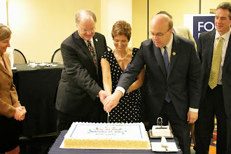 Photo: ubmitted by Save the Children  Rep. Sam Farr (D-CA), Rep. James McGovern (D-MA), and Dina Esposito, Director of the Office of Food for Peace, celebrating the 60th anniversary of Food for Peace at a cake-cutting ceremony at the TOPS/FSN Network Knowledge Sharing Meeting.