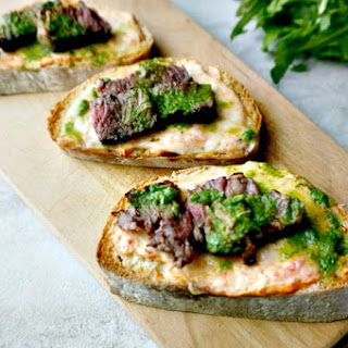 Steak Crostini with Roasted Red Pepper Spread and Arugula Pesto