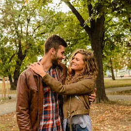 Modern couple enjoying the time in the city park by Vera Arsic - People Couples ( young women, romance, two people, friendship, heterosexual couple, city life, togetherness, young adult, embracing, model, hugging, smiling, attractive, tree, lovers, lifestyles, girlfriend, enjoyment, color image, love - emotion, adult, photography, handsome, couple - relationship, city, 20-29 years, boyfriend, casual clothing, affectionate, modern, romantic, happiness, joy, grass, dating, flirting, caucasian ethnicity, public park, nature, carefree, sexy, intimate, young men, people, young couple, outdoors, hug, feelings, fun, fashion )