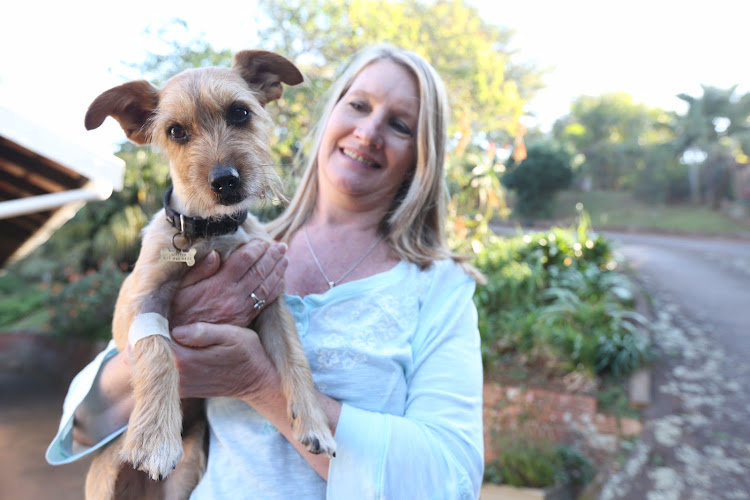 Morag Liebenberg with her lucky dog Jasper who killed a black mamba and survived the venom after having four vials of antivenom.