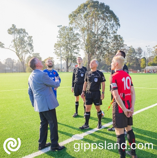 Mayor of Baw Baw Shire Councillor Danny Goss flips the coin before kickoff