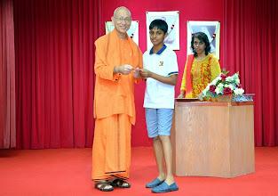 Photo: Trishan Manav Sriram (PSLE) receiving the Award from Swamiji
