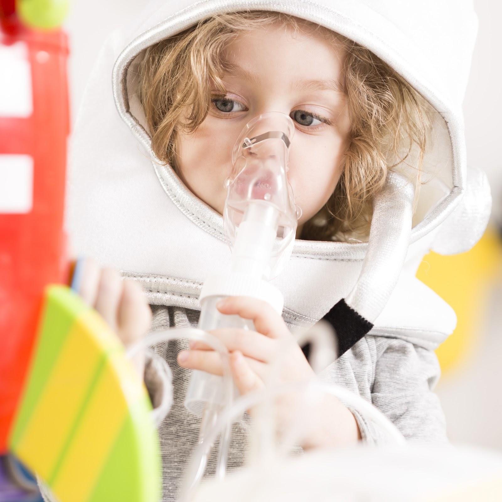 Kid taking nebulizer silver