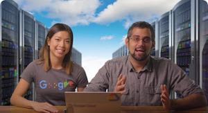 Google Developer Advocates Stephanie Wong and Mark Mirchandani sit side-by-side at desk with a laptop open in front of them