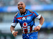 Cornal Hendricks celebrates after Jesse Kriel scored a try for the Vodacom Bulls during a Super Rugby match against the Cell C Sharks at Kingsmead Stadium in Durban on March 30 2019.