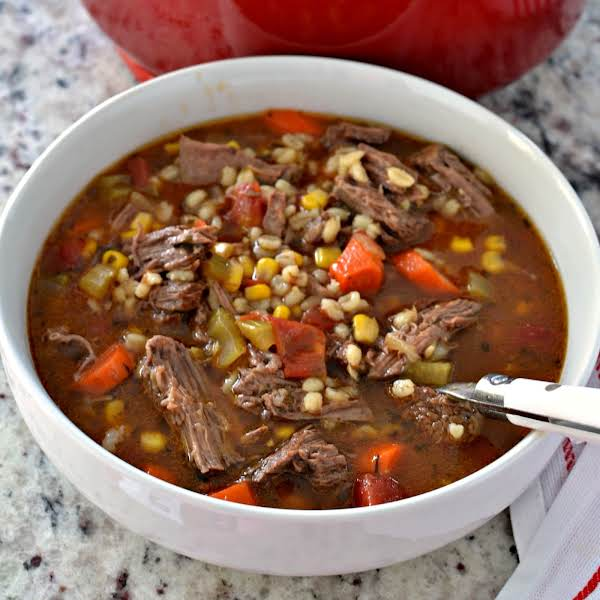 Beef And Barley Soup Is A Delectable Combination Of Beef, Carrots, Celery, Onions, Tomatoes, Corn And Barley In A Deliciously Seasoned Beef Broth.  This Delicious Soup Can Be Made Quickly With Stew Or Simmered Low And Slow With Chuck Roast.