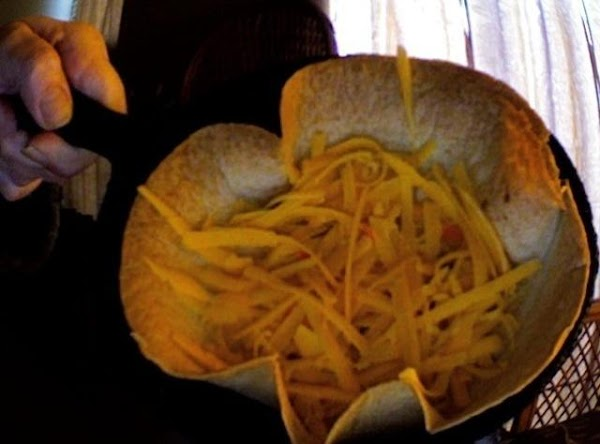 sprinkle cheese sparingly on the inside bottom of baked crispy shell