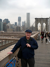 "Photo: Nearing the end of the Brooklyn Bridge on the eastern side.  ""New York by Gehry,"" 8 Spruce St., rises above my cap."