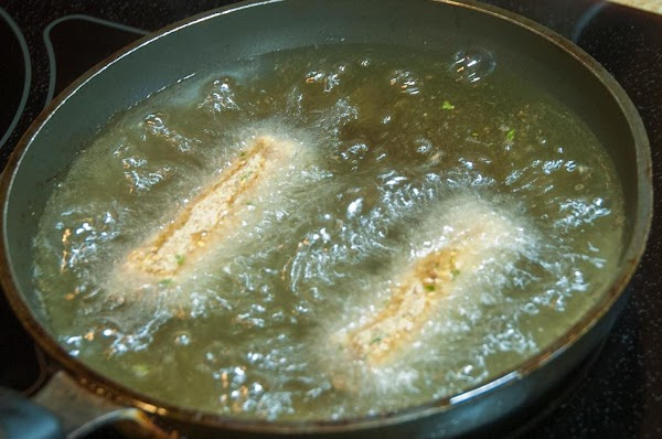Fry the croquettes until golden brown, about 2 to 4 minutes.