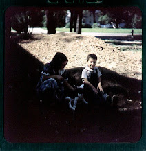 Photo: Barb and Pete in a pile of dirt? :-)