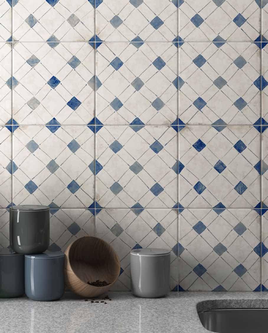 Square tile kitchen backsplash with a blue pattern