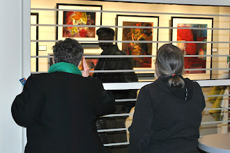 Photo: Attendees enjoy the new gallery.