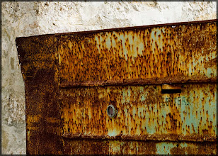 Photo: A rusty door with a letter box