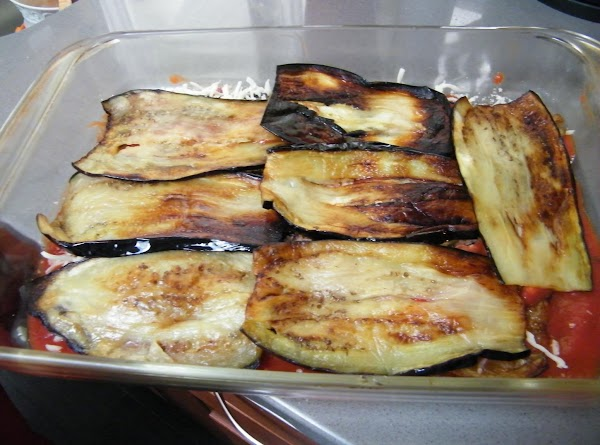 Line bottom of baking dish with sauce, then layer eggplant, diced or thinly sliced...